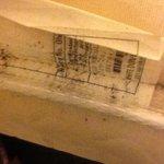 visible bed bug feces under the sheets at the foot of the bed.  This is the ma