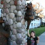  Bears decorate the outside of the hotel, where my daughter is eating a cookie from the hotel