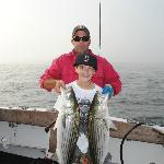 took awhile for this 11 year old to land both of these striped bass at once!