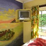  The sunset room bedroom and its art