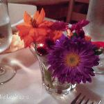  Lovely intimate table setting with their own flowers.