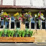 Pretty flower baskets along the front of the lodge