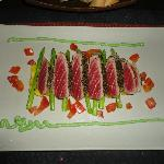 Tuna steak on roasted pineapple and Thai asparagus with wasabi sauce