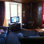 The TV Room next to the roaring fire
