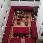 Inside the hotel looking down at the restaurant & bar.