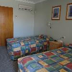 Twin room with a queen bed and single bed for a maximum of 3 guests.