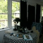 View of dining area inside the Guest House, overlooking the sun porch