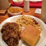  chopped pork, Mac-n-cheese, sweet potato souffle and corn bread.
