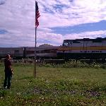 Waving as the Grand Canyon Railroad train passes.