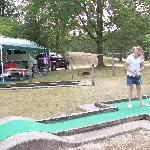 Grand-daughter Sarah playing minature golf with our RV in the background. Look how large this s