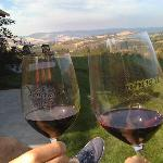 Toasting with our complimentary glasses of FABULOUS red wine!
