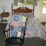 Bed with rocking chair & afgan