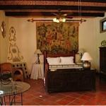 Bedroom and fireplace of The Casita