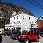 Street view of the hotel surrounded by 13-14 thousand foot mountains