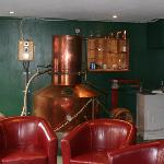  inside before you get to the bar, is a copper distiller