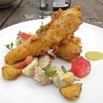 Fried chicken with potato salad, watermelon, crispy pickle and spicy ranch