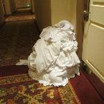 Linen left in hallway at 4 pm.