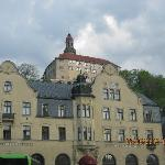 View of hotel from the front with Castle on hill above.