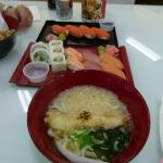 Chicken teryaki, artic char sushi, combo sushi and bowl of udon