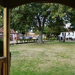  View from the summerhouse, showing stable block and garden