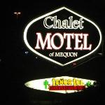  The motel sign lit at night
