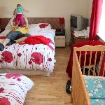 Queen bed, double sofa bed and baby cot... and still loads of space to move around!