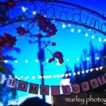  Garden sign with strings of lights in the background