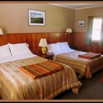 Choose from rooms with one queen bed or two double beds
