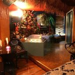 Hawaii Suite.  Lava rock surround the large hot tub.  Plan your Hawaiian retreat today.