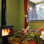 Relax in the warmth of a glowing log fire