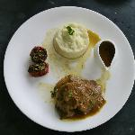 Mutton caillettes,with fresh herbs,thyme reduction and creamy potato gratin.