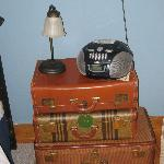  Three antique suitcases form the nightstand