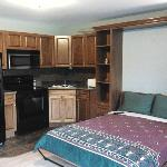 New kitchen with full sized appliances, across from the bed is a 42