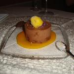 Dark Chocolate mousee served with black olive and cocoa paste, blue iranian salt andmango sauce
