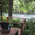 Outside the door to the cabin, on the patio, looking at river!