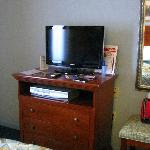  tv and chest of draws in bedroom