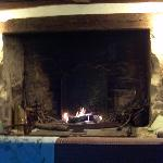 view of the huge inglenook fireplace in the guests' sitting room