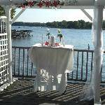 Wedding held on deck overlooking lake