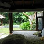 Back room of our villa, with daybed and view of private garden