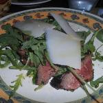 Tagliata rucola e grana (specially cut veal with rucola and slices of cheese)