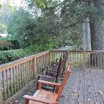Deck behind Lodge along creek.