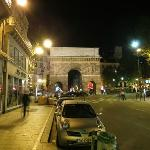 Near the metro station, the hotel street (rue) is just to the right of the arch.
