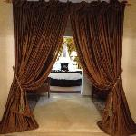 The curtains into the bedroom.