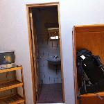 T.V, closet and Bathroom entrance.