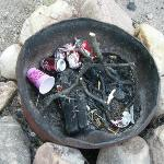 Campsite not clean before our arrival... trash in fire pit.