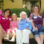 5 generations pose in the courtyard