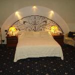  king size bed with special rought iron headboard and concealed lighting