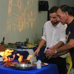 Bruno and his father cooking chorizo