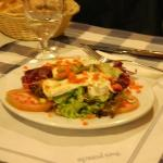 Mixed salad starter with three slabs of warm camembert across the top