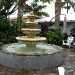 Beautiful Fountain in the Middle of the Garden with tables and chairs all around to enjoy the vi